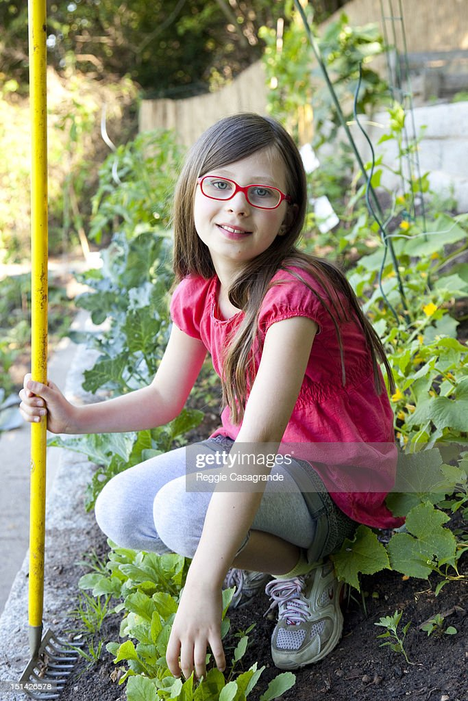 Young girl taking a break from gardening : Stock Photo