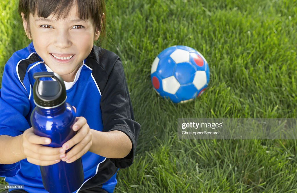 Young girl taking a break from soccer : Stock Photo