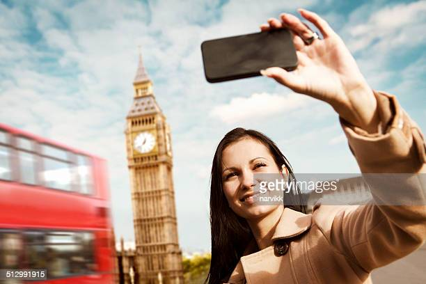 Young girl taking a selfie at Big Ben in London