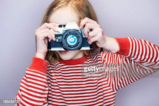 young girl taking photo with 35mm camera : Stock Photo