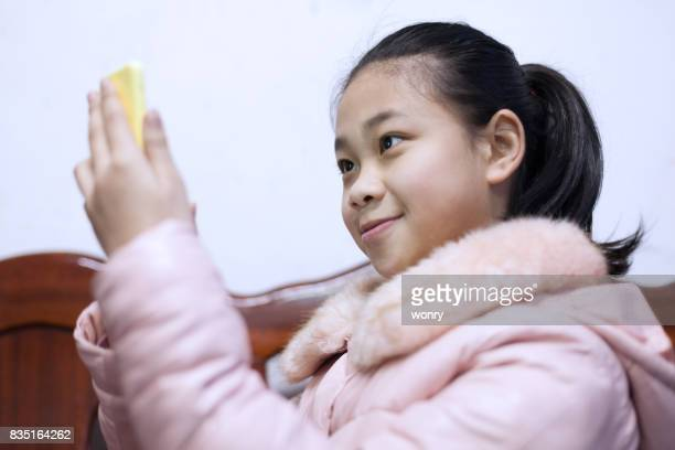 Young girl taking self portrait photography indoors