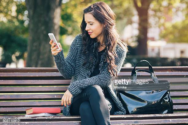 Young girl texting on a smart phone