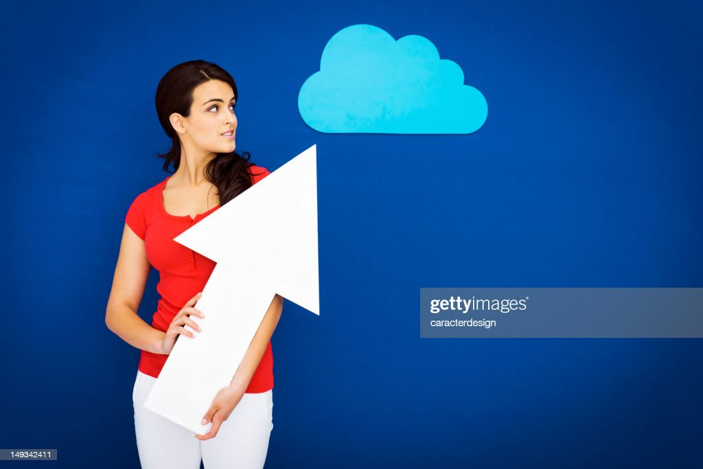 Young girl uploading to the cloud : Stock Photo
