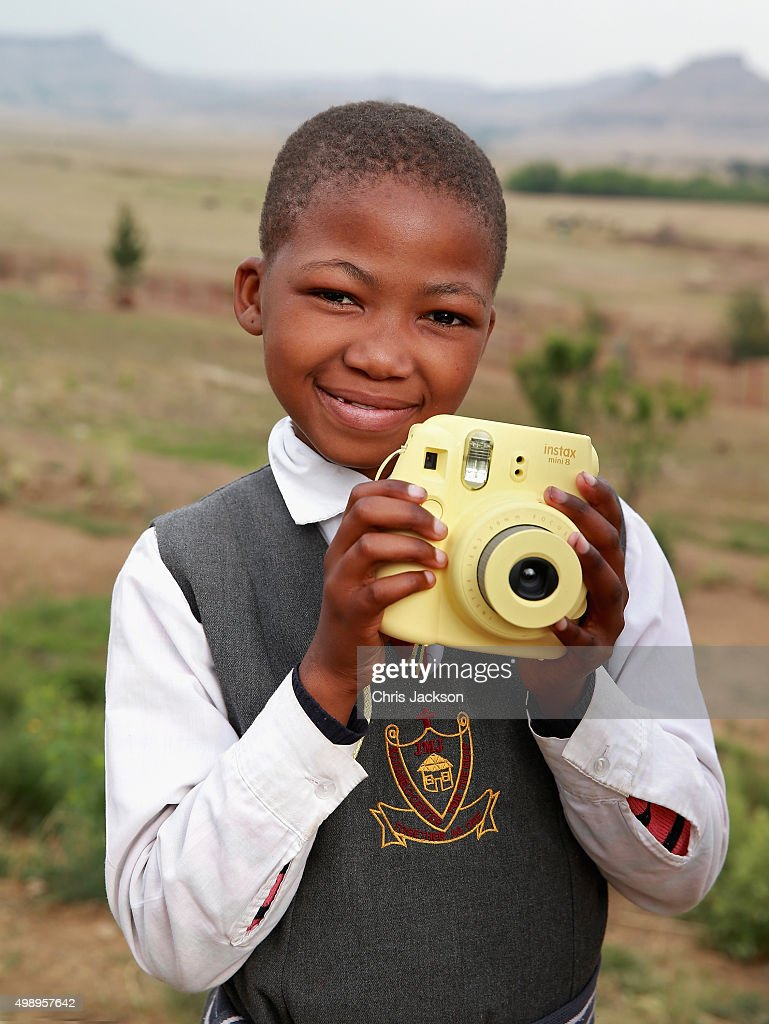A young girl uses a Fuji Instax Camera during an instant photography session at Kananelo Centre School for the deaf on October 17, 2015 in Maseru, Lesotho. Getty Images have partnered with Prince Harry's Charity Sentebale to help bring photography to some of the vulnerable children of Lesotho. In an ongoing project and with the Support of Fujifilm Getty Images has helped develop and run lessons with children at the new Sentebale Mamohato Children's Centre as a way of helping develop interpersonal, creative and communication skills amongst some of the most disadvantaged children in the world. Sentebale was founded by Prince Harry and Prince Seeiso of Lesotho ten years ago.