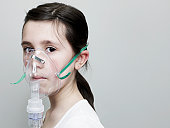Young Girl Using an Oxygen Mask.