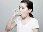 Young Girl Using Asthma Inhaler.  MDI.