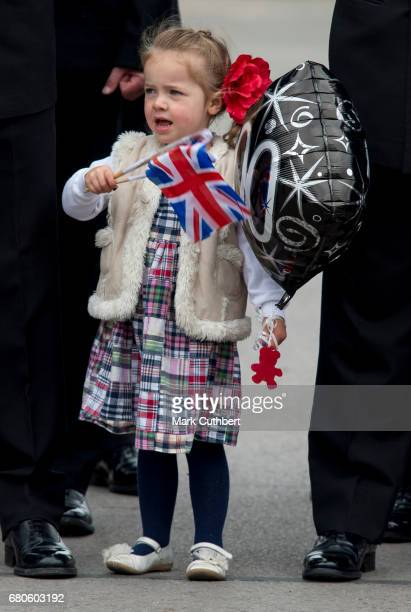 A young girl waiting for Queen Elizabeth II to arrive for her visit to Pangbourne College to celebrate it's centenary on May 9 2017 in Pangbourne...