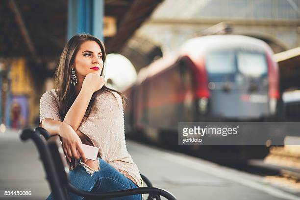 young girl waiting the train