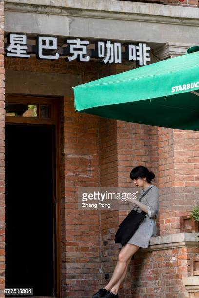 A young girl waits outside a Starbucks shop Since June 1st 2017 the fulltime employees of Starbucks in Chinese market who have worked for two years...