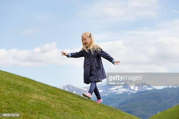 Young girl walking uphill