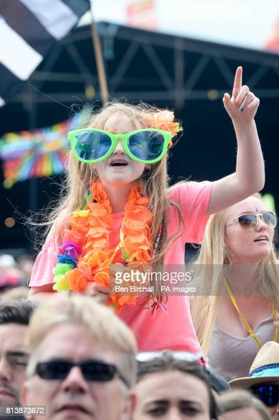 A young girl watches Rag n Bone man perform on the Other Stage at Glastonbury Festival Worthy Farm Somerset PRESS ASSOCIATION Photo Picture date...