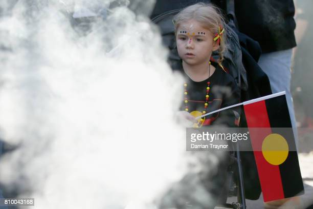 A young girl watches the smoking ceremony at the 2017 NAIDOC March on July 7 2017 in Melbourne Australia The march was organised to call for a day of...