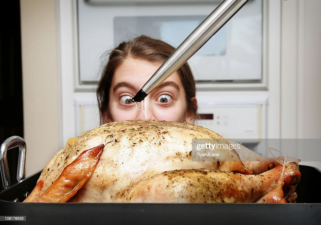 Young Girl Watching Thanksgiving Turkey Being Prepared