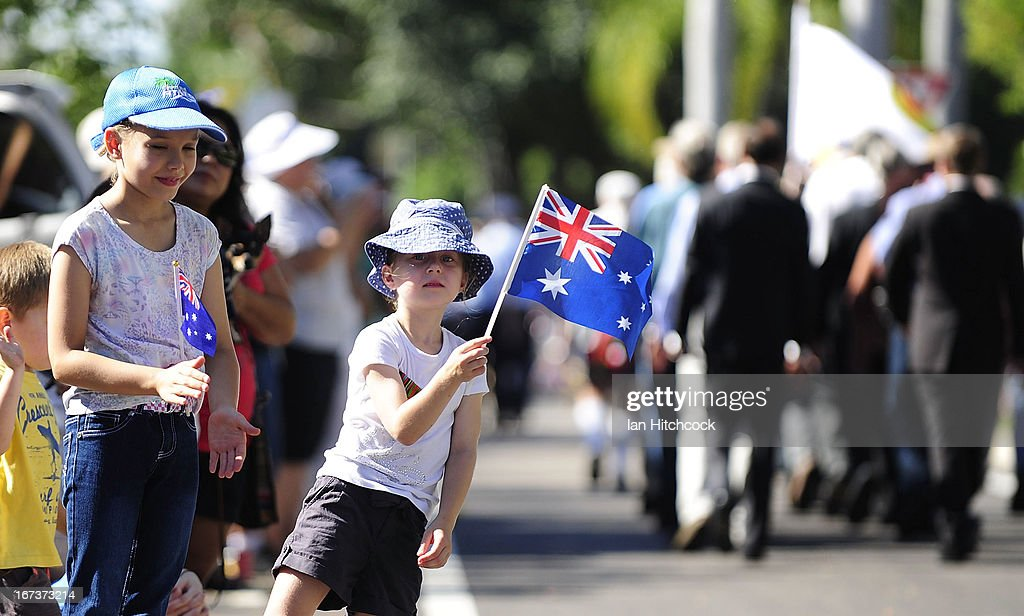 A young girl waves the Australian flag as veterans walk past her during the ANZAC Day march on April 25, 2013 in Townsville, Australia. Veterans, dignitaries and members of the public today marked the 98th anniversary of ANZAC (Australia New Zealand Army Corps) Day, April 25, 1915 when allied Australian and New Zealand First World War forces landed on the Gallipoli Peninsula. Commemoration events are held across both countries in remembrance of those who fought and died in all wars.