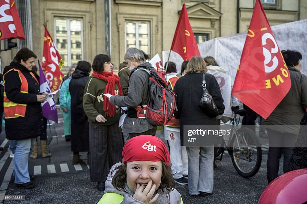 A young girl wearing a CGT trade union's bandana demonstrates as members of the public sector, (education, health and finance) take part on January 31, 2013 in a national day of protest in Lyon against the French government's social policy. For the first time since French President Francois Hollande's election, three labour unions (CGT, FSU, Solidaires) called on 5.2 million civil servants to stop working to show to the government their unhappiness, particularly in terms of purchasing power. AFP PHOTO / JEFF PACHOUD