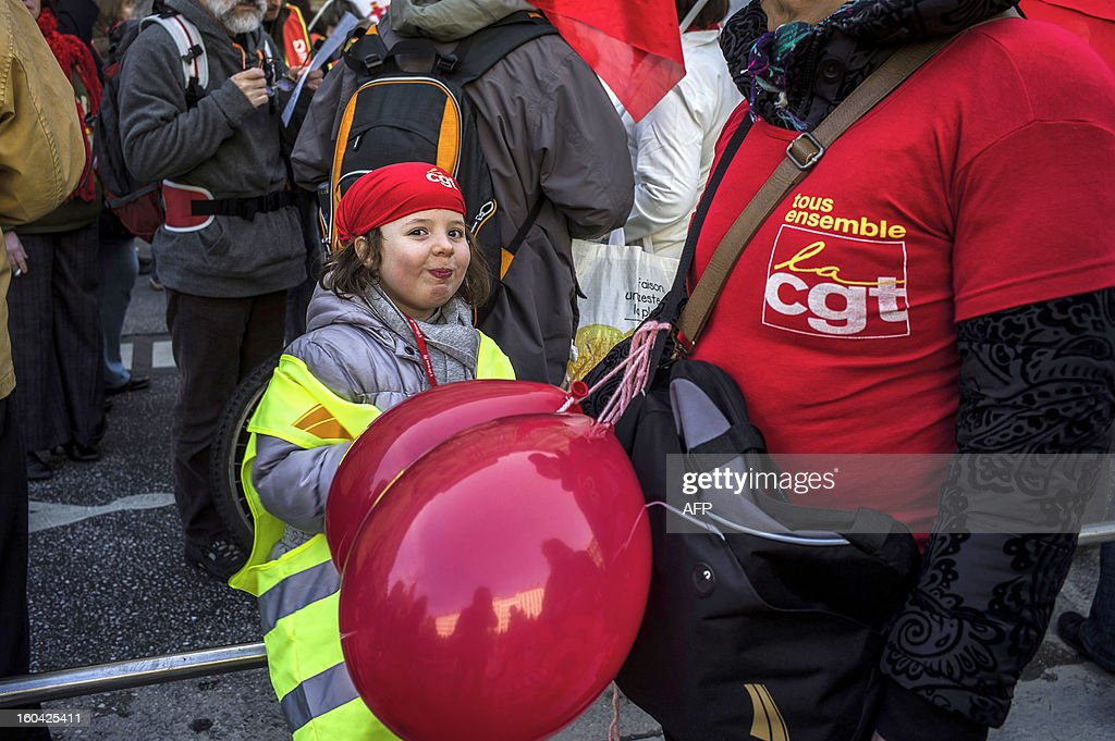 A young girl wearing a CGT union's bandana demonstrates as members of the public sector, (education, health and finance) take part on January 31, 2013 in a national day of protest in Lyon against the French government's social policy. For the first time since French President Francois Hollande's election, three labour unions (CGT, FSU, Solidaires) called on 5.2 million civil servants to stop working to show to the government their unhappiness, particularly in terms of purchasing power.
