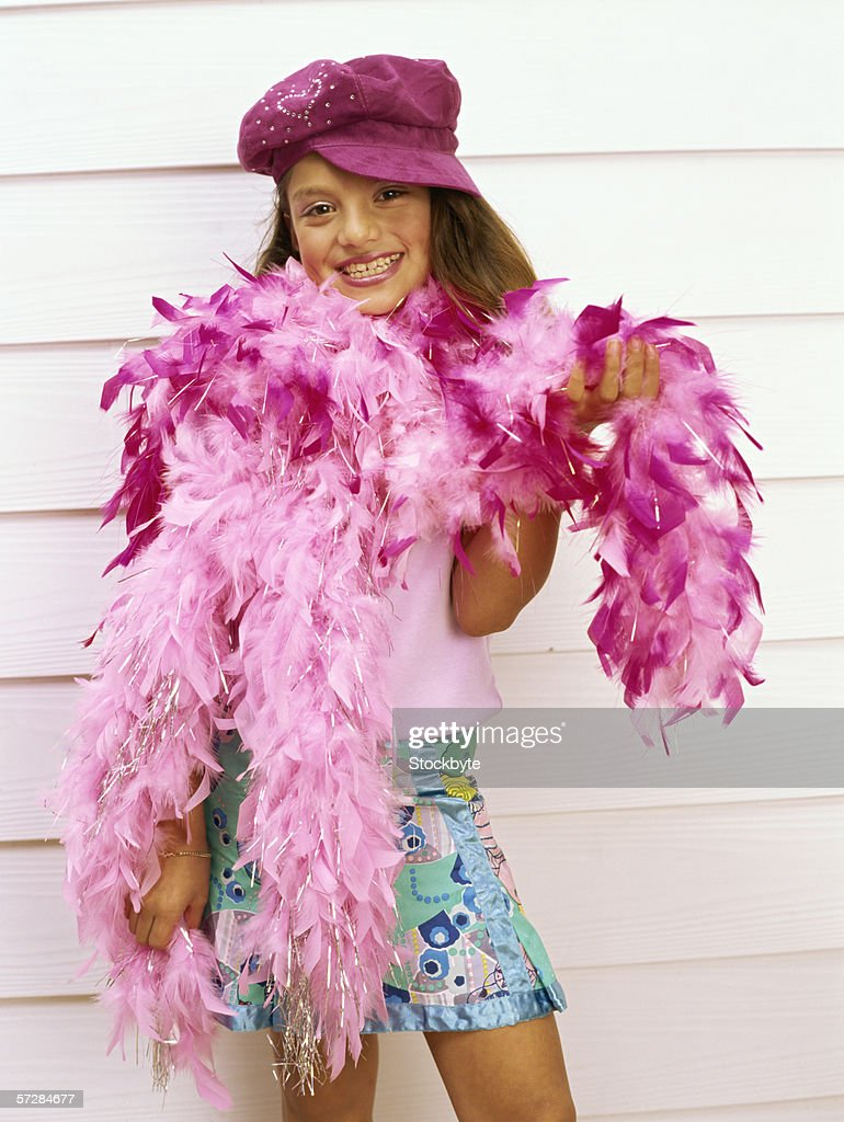 Young girl wearing a feather boa
