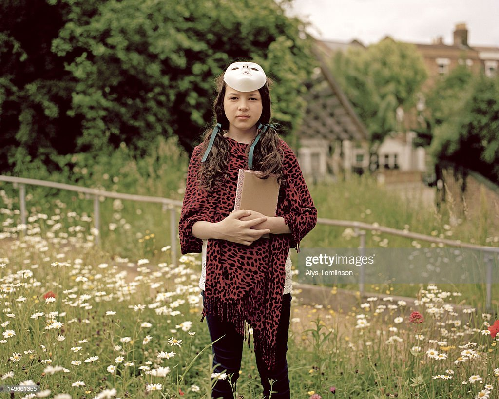 Young Girl Wearing a Mask Outdoors in Countryside : Stock Photo