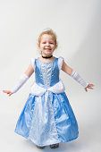 Young girl wearing a princess Halloween costume.