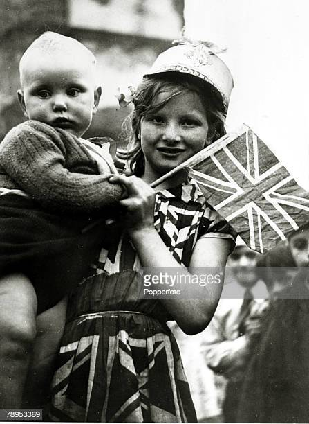 8th May 1945 London A young girl and baby on VEDay enjoying the celebrations