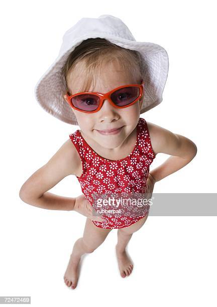 Young girl wearing beach hat and sunglasses