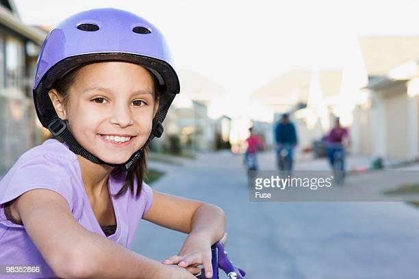 Young girl wearing bicycle helmet