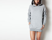 Young girl wearing blank and oversize long hoody. White background. Horizontal