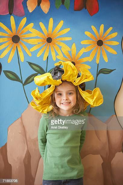 Young girl wearing flower hat