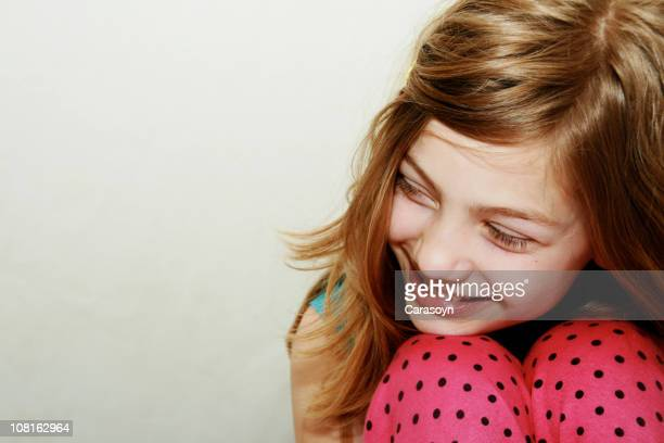 Young Girl Wearing Pink Polka Dotted Pants Smiling