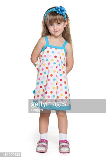 Young Girl Wearing Polka Dot Dress Stock Photo | Thinkstock