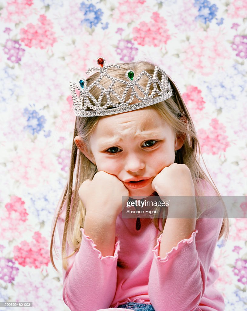 Young girl (4-6) wearing tiara with sad face, portrait : Stock Photo