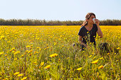 There is young girl in flowery field in Cyprus.