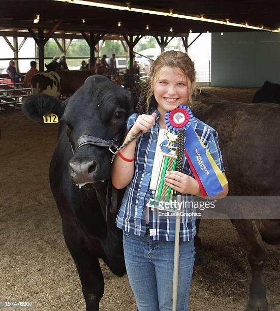 Young girl winning a competition with her cow