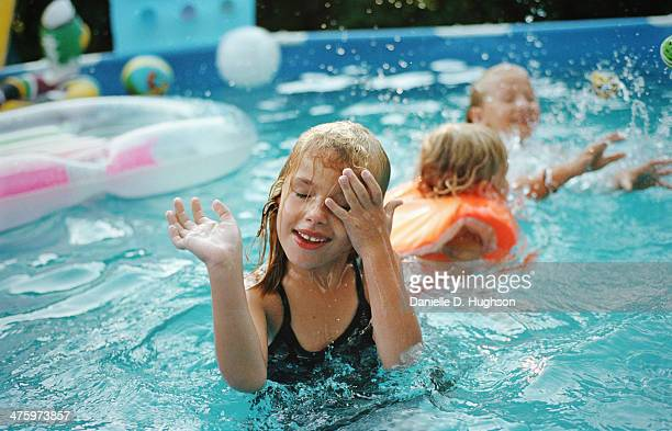 Young Girl Wiping Her Eyes In Swimming Pool