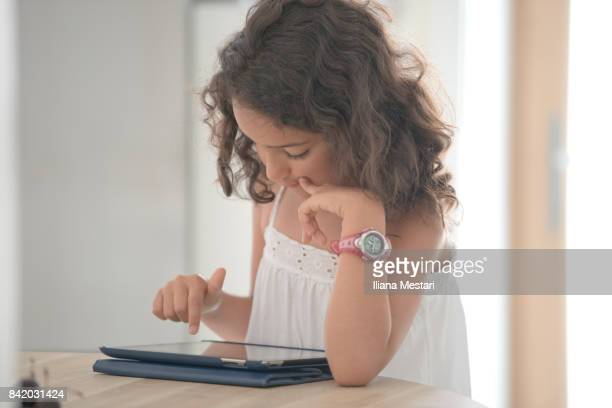 A young girl with a digital tablet