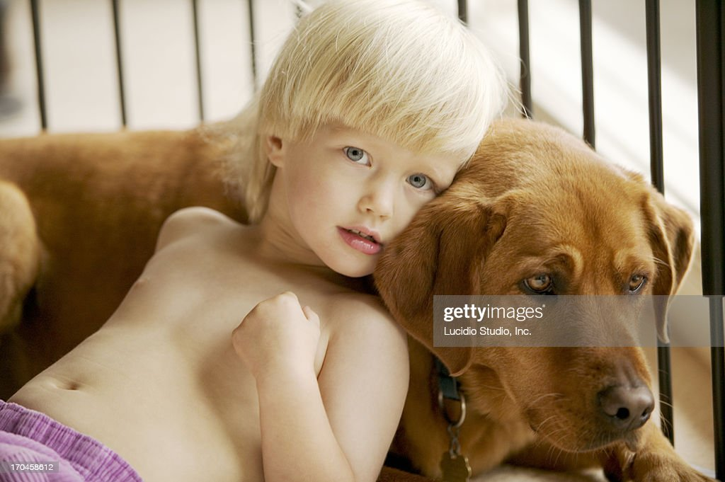 Young girl with a Labrador dog : Stock Photo