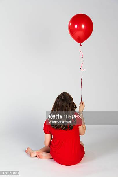 Young Girl With a Single Red Balloon
