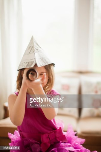 Young girl with a telescope