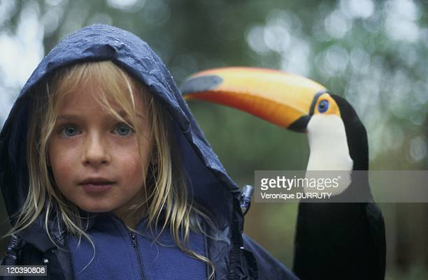 Young girl with a toucan Iguazu in Brazil in 2005