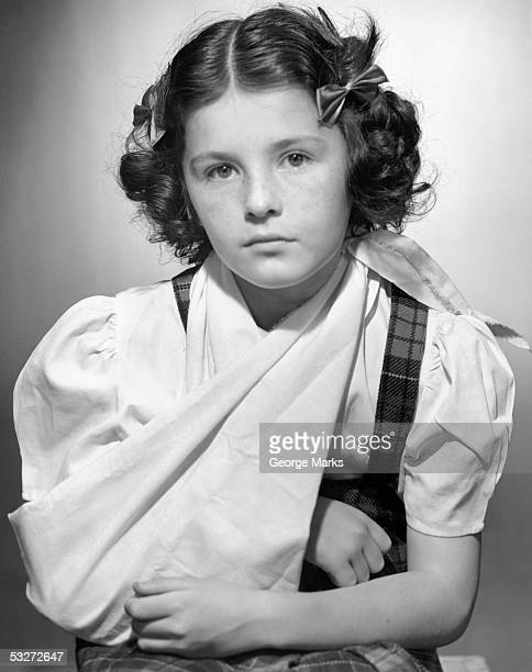 Young girl with arm in sling