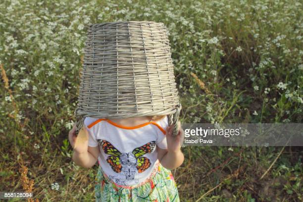 Young girl (3-4 years) with basket on her head