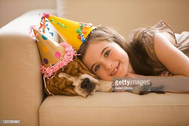 Young girl with beagle on the couch