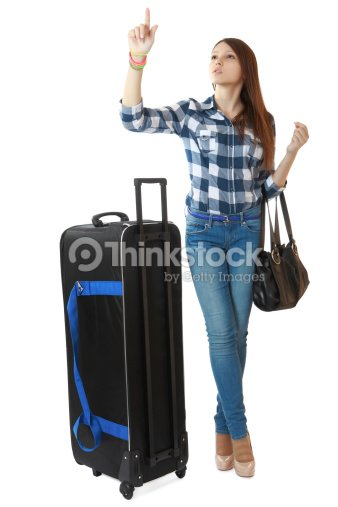 jeune fille avec gros noir sac de voyage roulettes photo thinkstock. Black Bedroom Furniture Sets. Home Design Ideas