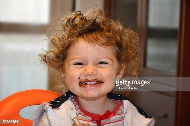 Young girl with chocolate on face