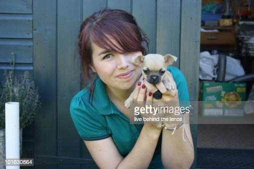 Young girl with  cute puppy, smiling, portrait