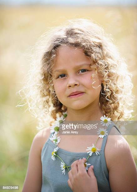 Young girl with daisy chain necklace