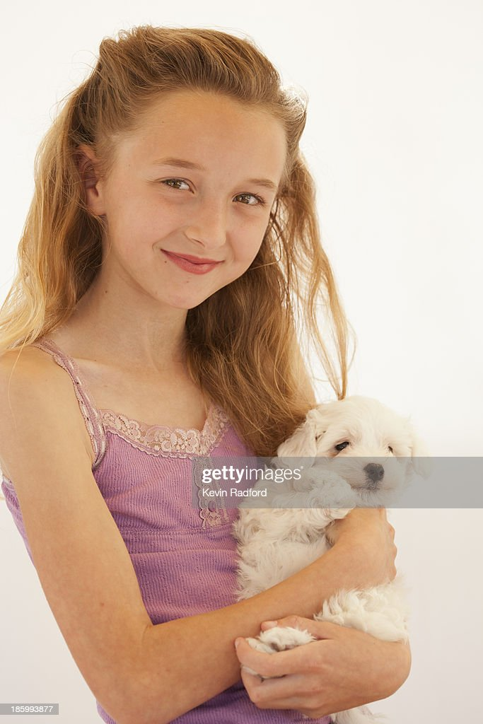 Young girl with dog in studio. : Stock Photo