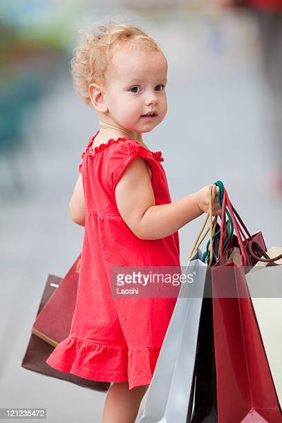 Young girl with full of bags