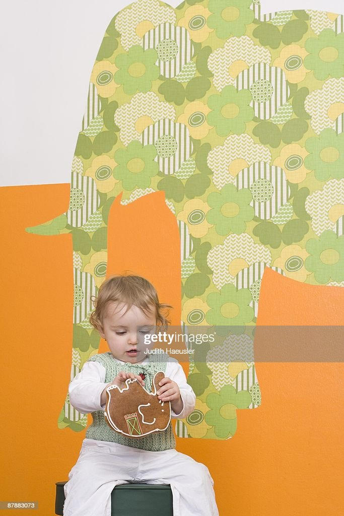 Young girl with gingerbread elephant : Stock Photo