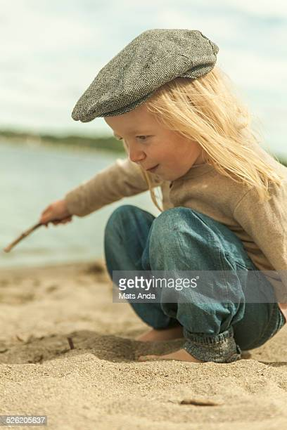 Young girl with hat at beach